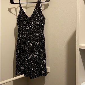 Black skater dress with music pattern